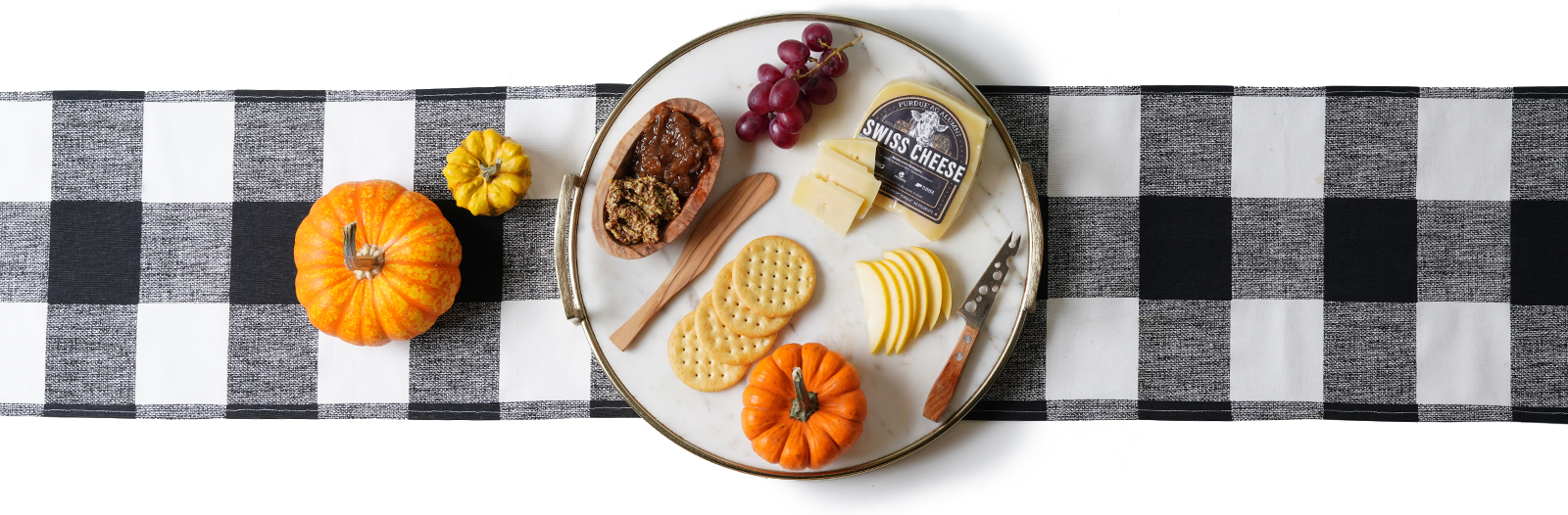 Decorated plate with Purdue Ag Alumni Swiss Cheese