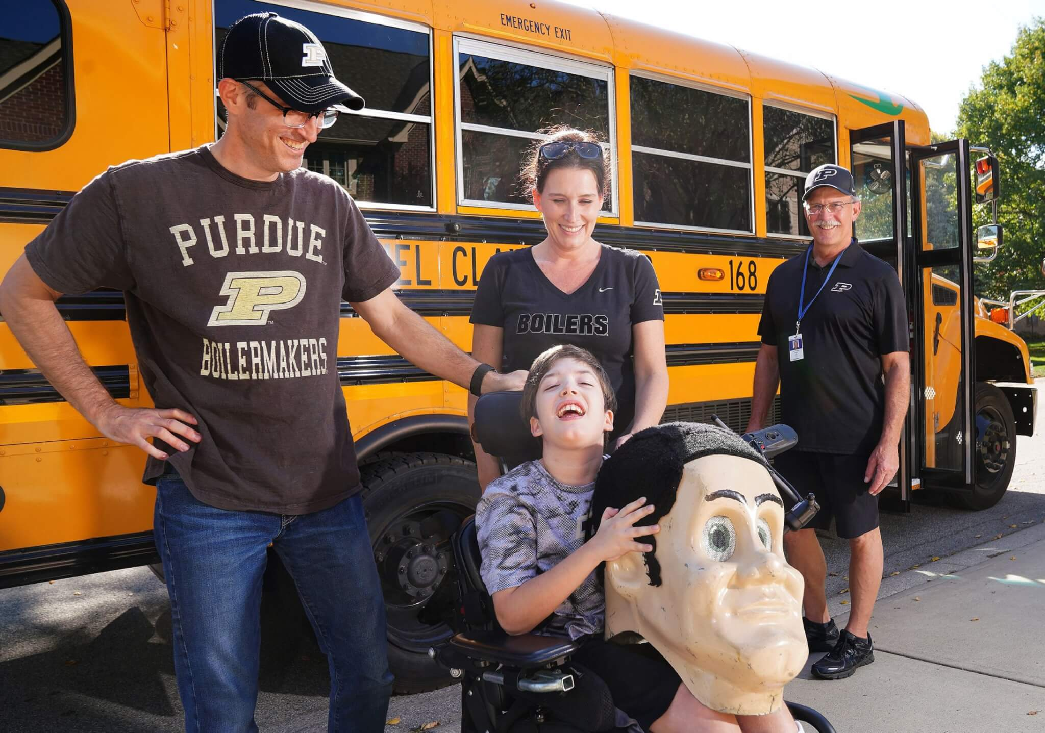 Former Purdue Pete and local family in front of bus