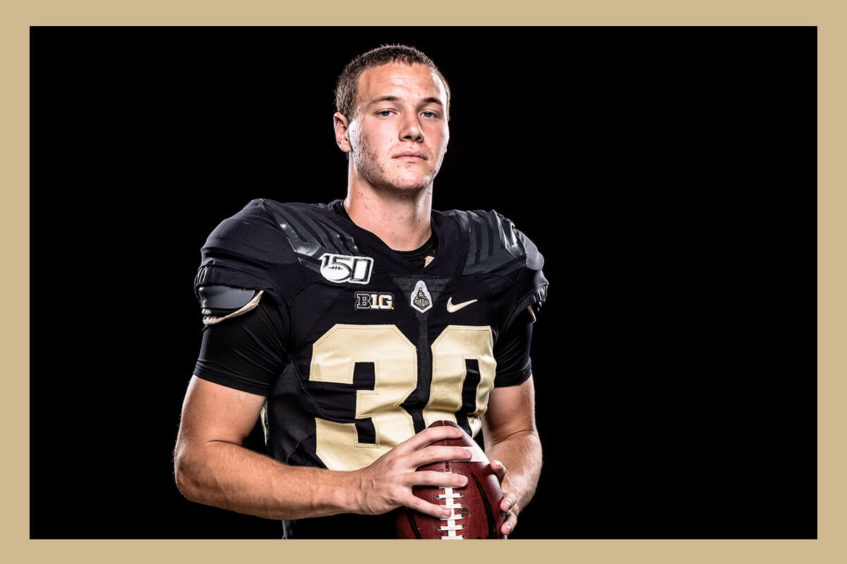Brooks Royal playing football for Purdue