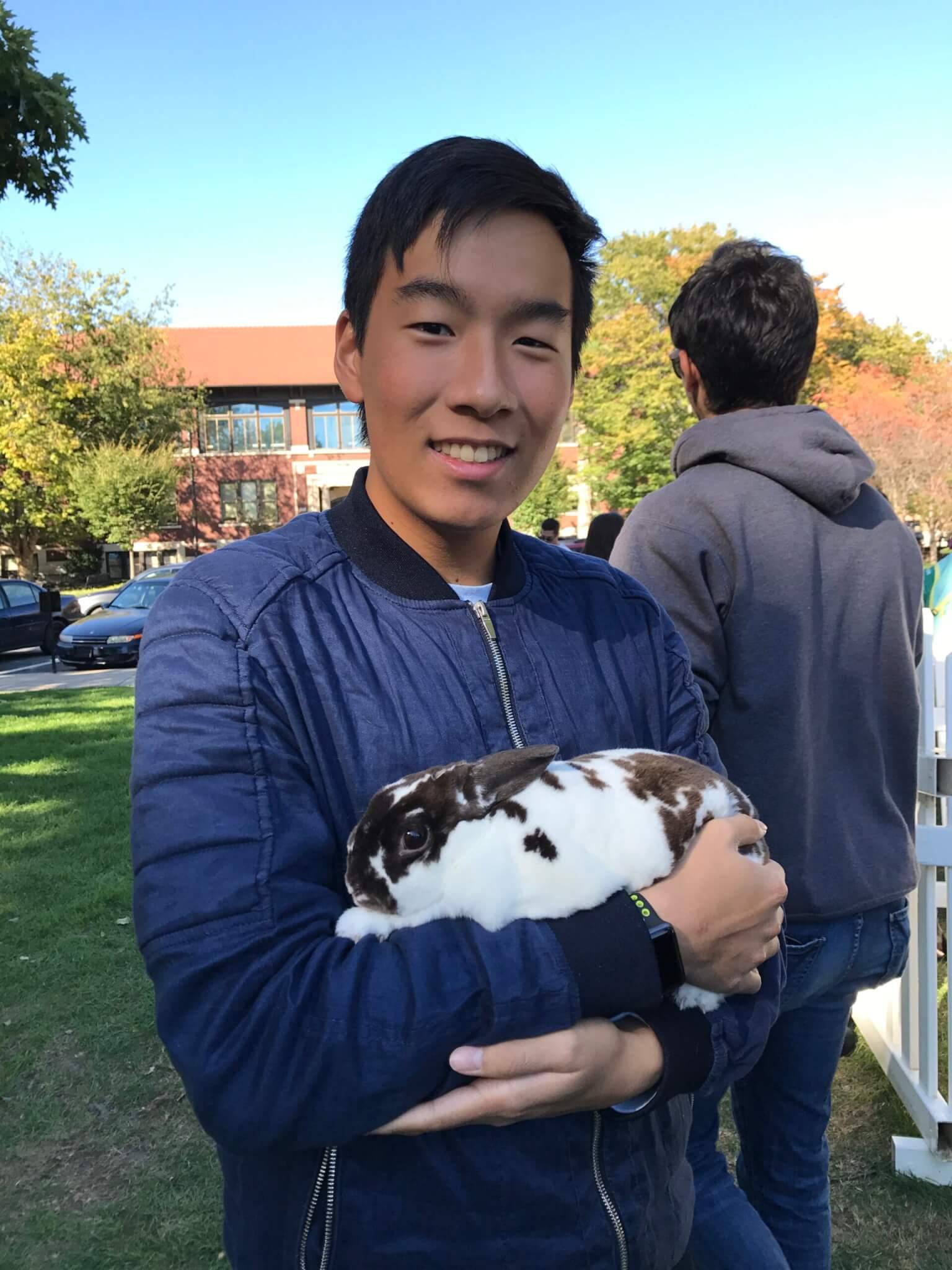 Cheng holding a rabbit