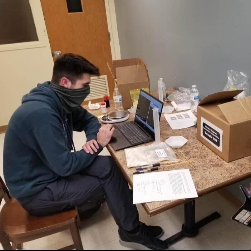Nauman working on a laptop