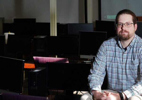 Ben Hancock on a desk