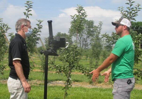 """Peter Hirst, Purdue Extension fruit specialist, speaks with Calvin Beasley, owner of Beasley's Orchard, during filming of the virtual fruit and vegetable field day."""