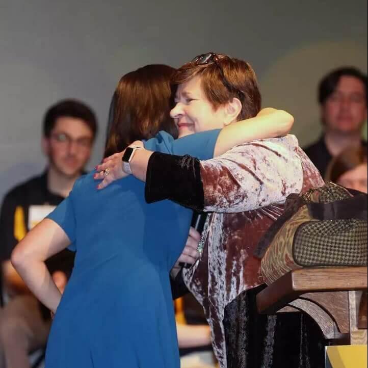 Jocelyn Wong hugging Jane Ade Stevens
